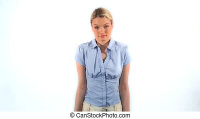 Peaceful woman shrugging her shoulders