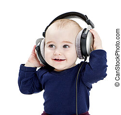 young child with ear-phones listening to music - young child...