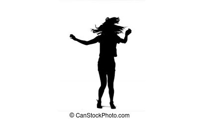 Woman silhouette dancing in slow motion