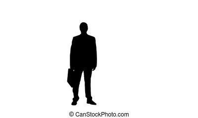 Silhouette of a man in slow motion throwing a briefcase -...
