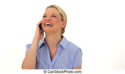 Smiling woman using her cellphone against a white background