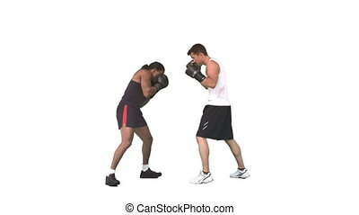 Two men sparring together with gloves in slow motion against...