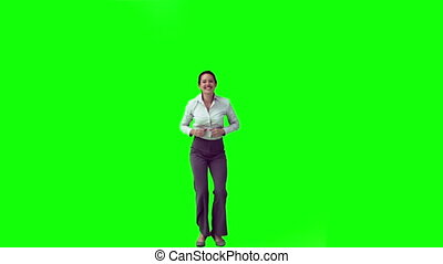 Happy secretary in slow motion jumping against a green...