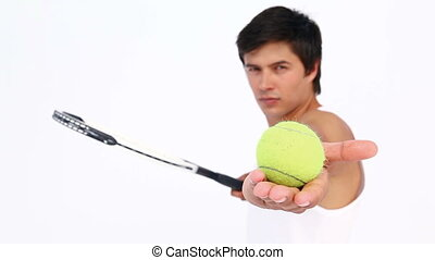 Man does rebounds with his ball on a tennis racket againt...