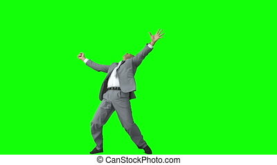 Happy businessman in slow motion raising his arms against a...