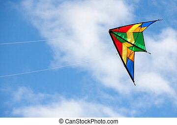 Nice kite flying colors against the blue sky