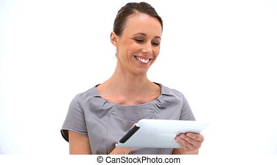 Smiling woman using a tablet pc against a white background