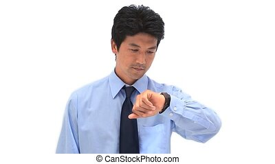 Businessman looking at his watch against a white background