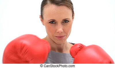Woman boxing with red gloves