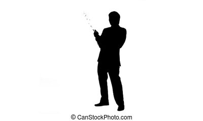 Silhouette of a man with champagne in slow motion