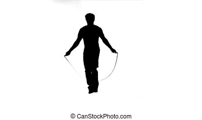 Silhouette of a man skipping against a white background