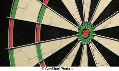 Single dart hits bulls eye close up