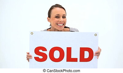 Happy woman holding a placard against a white background