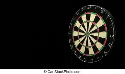 Three darts hit dartboard including the bulls eye