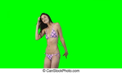 Girl in bikini jumping - Dark haired girl in bikini jumping...