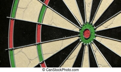Close up of three darts on dartboard