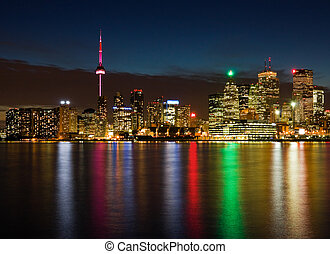 Toronto at night, Canada - Skyscrapers next to Ontario Lake...