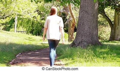 Woman walking in a park