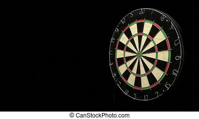 Three darts including bulls eye - Wide shot of three darts...