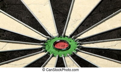Three darts including bulls eye - Low angle on dartboard...