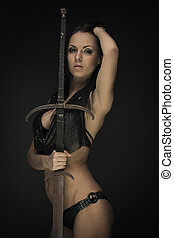 Amazon with sword - Portrait of gorgeous brunette woman with...