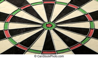 Three darts including bulls eye