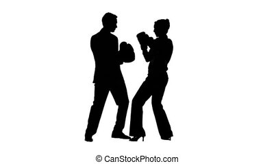 Colleagues in slow motion boxing against a white background
