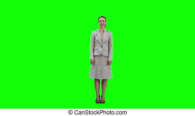 Smiling woman in slow motion raising her arms