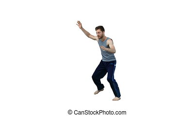 Man performing dance martial arts in slow motion against a...