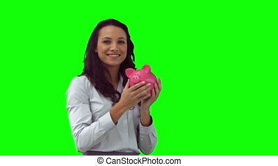 Woman in slow motion holding a piggy bank