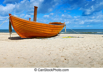 Fishing Boat - Wooden fishing boat on a sandy beach in sunny...