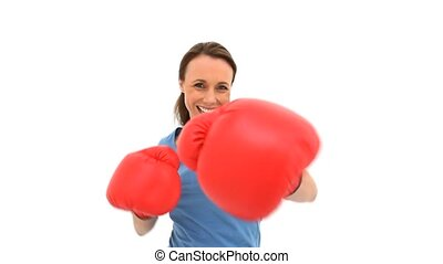 Smiling woman playing with boxing gloves