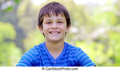 Smiling child placing his thumbs up