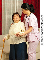Nurse helping elderly woman home - Nurse helping elderly...