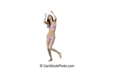 Girl dancing in a bikinni