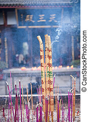 Burning incense in the temple
