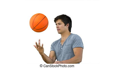 Man spinning a ball on his finger in slow motion