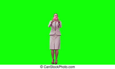 Businesswoman in slow motion throwing a piggy bank