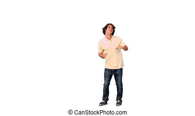 Man happily dancing in slow motion against a white...