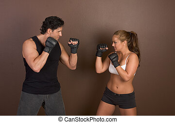 Female kick boxer with trainer in sparring Workout - Woman...