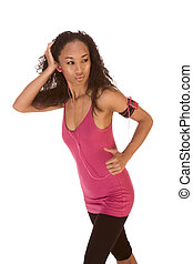 Ethnic woman fitness work out with music - Young biracial...