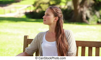 Young woman relaxing on a bench