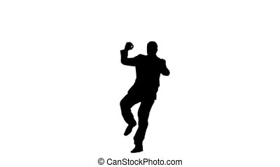 Silhouette of a man in slow motion jumping