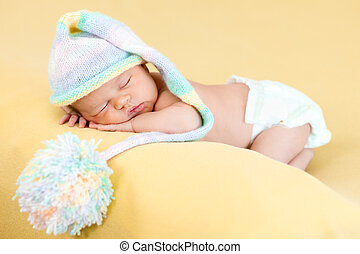 adorable baby girl weared cap sleeping on her stomach -...