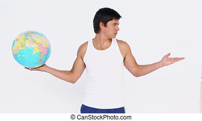 Man holding a globe in one hand and a blank space in the...