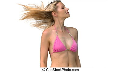 Woman in pink bikini turning head in slow motion
