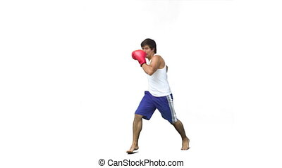 Man kick-boxing in slow motion against a white background