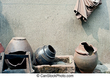 Dilapidated old house and the soil pots