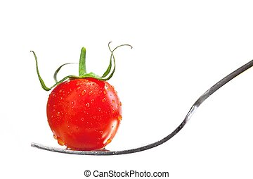 Tomato on a fork isolated on white