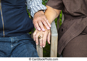 senior couple holding hands in love